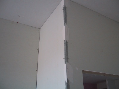 A plasterers external angle pinned with clouts and basecoat